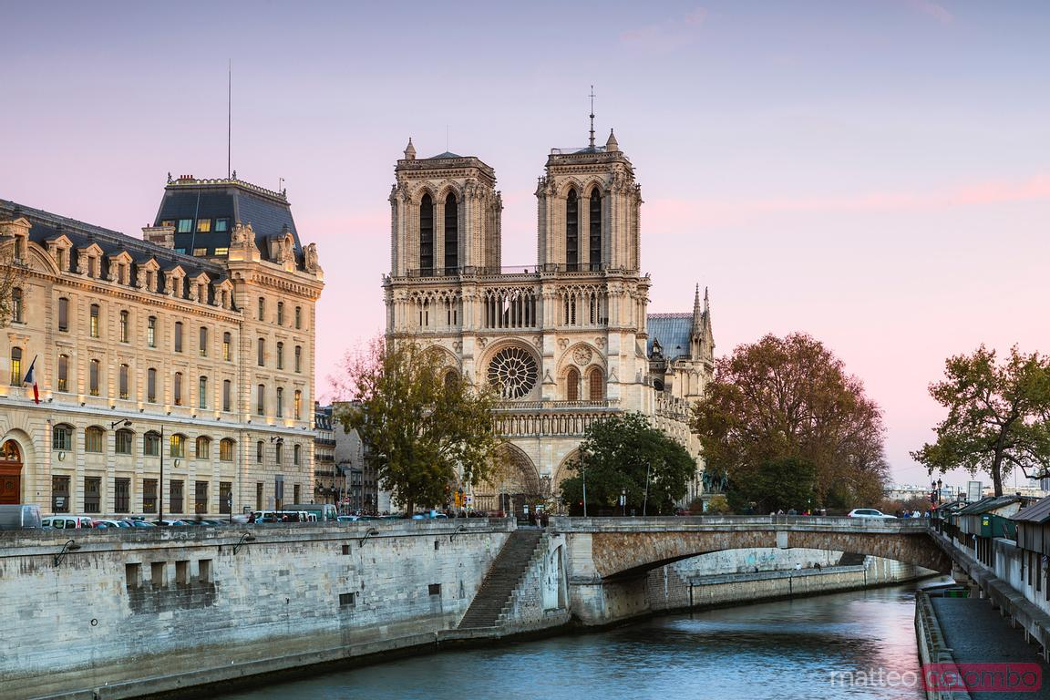 Notre Dame cathedral under colorful sky, Paris, France
