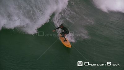 Slow motion shot of a surfer riding big waves. Eastern Cape South Africa