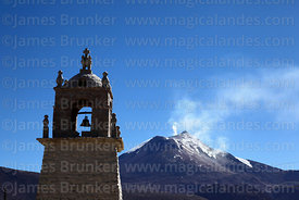 Guallatiri village church bell tower, Guallatiri volcano in background, Las Vicuñas National Reserve, Region XV, Chile