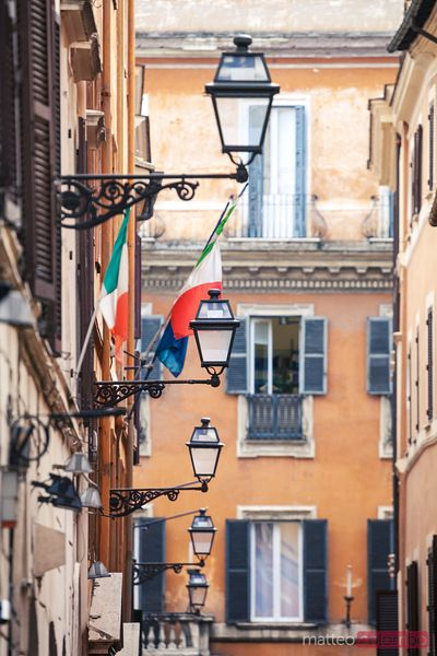 Street in the city centre with italian flags, Rome, Italy