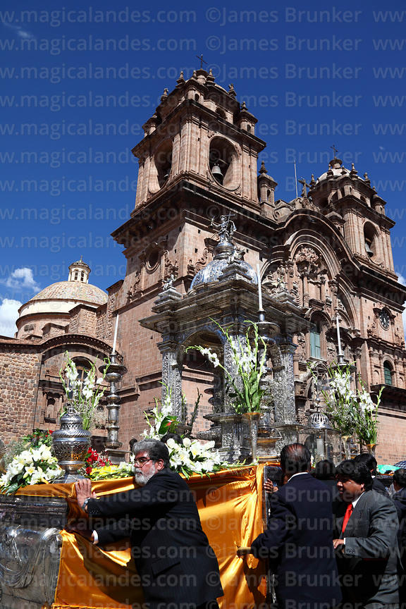 Silver Custodia passes Compañia de Jesus church during parades for Corpus Christi festival , Plaza de Armas , Cusco , Peru