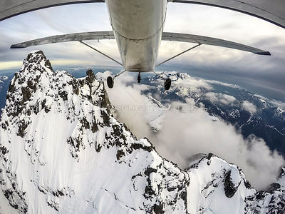 Point Of View of Airplane Exploring the Coastal Mountains of British Columbia
