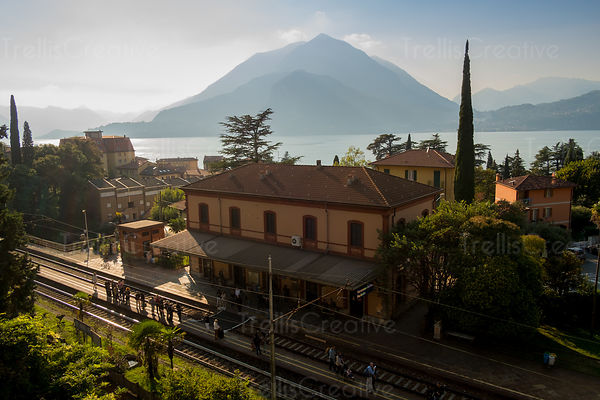 People wait at the train station in Varenna, Italy