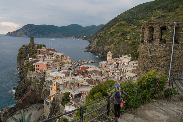 Woman looking at the Vernazza townscape in Cinque Terre