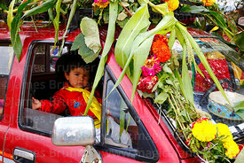 Boy wearing traditional dress in cab of a pick up truck during Carnival parades, San Lorenzo, Tarija Department, Bolivia