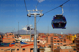 Blue Line cable car cabin, Mt Illimani in background, El Alto, Bolivia