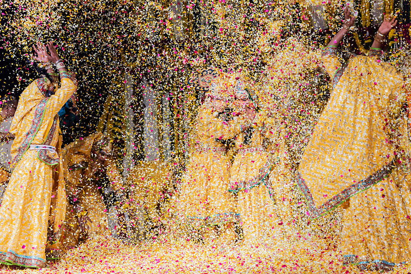 Reenactment of Krishna and Radha playing Holi with Flowers