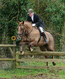Nick Wright jumping a hunt jump near Knossington Spinney