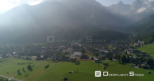 Alpine town, C4K aerial drone view of the Kranjska Gora town and Trigolov national park, on a sunny summer day, in the Julian...