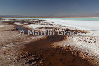 Laguna Tebinquiche, Salar de Atacama, showing the salt encrustation round the margin due to evaporation of the saline-rich wa...