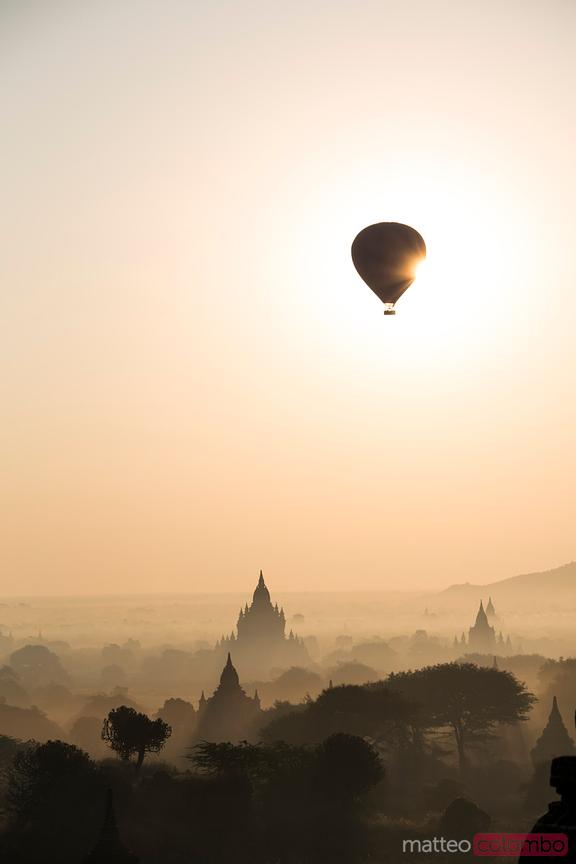 Hot air balloons over the temples of Bagan at sunrise, Myanmar