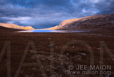 Light and shadow on lake, fells and tundra vegetation