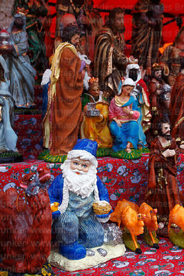 Santa Claus, Mary and wise men figures for nativity scenes for sale in Christmas market, La Paz, Bolivia