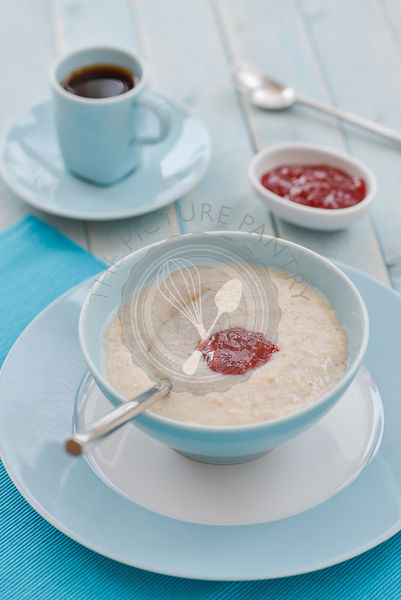 Porridge at breakfast, with coffee and jam.