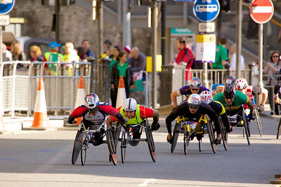 Kota Hokinoue (4th) of Japan followed by David Weir (2nd) from GB and Marcel Hug (1st) of Switzerland
