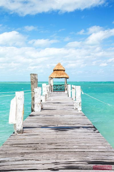 Jetty leading to tropical caribbean sea, Cancun, Mexico