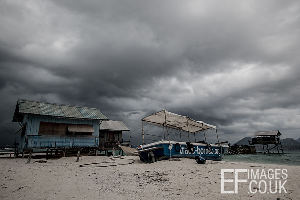 Stormy Skies Over Beach Shacks