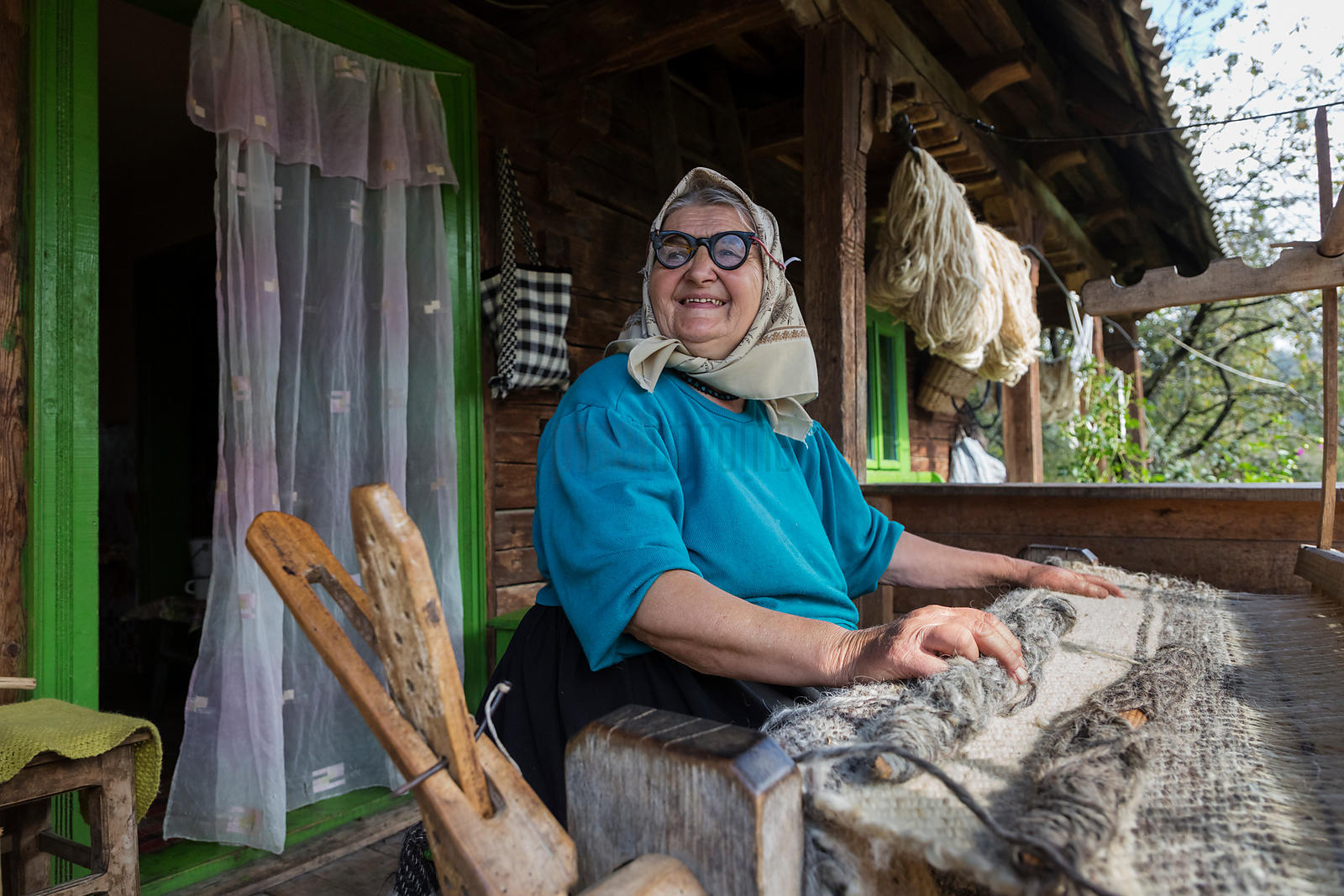 Portrait of Maria Weaving Wool on her Porch