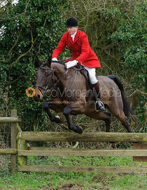 Nicholas Leeming jumping a hunt jump near Knossington Spinney