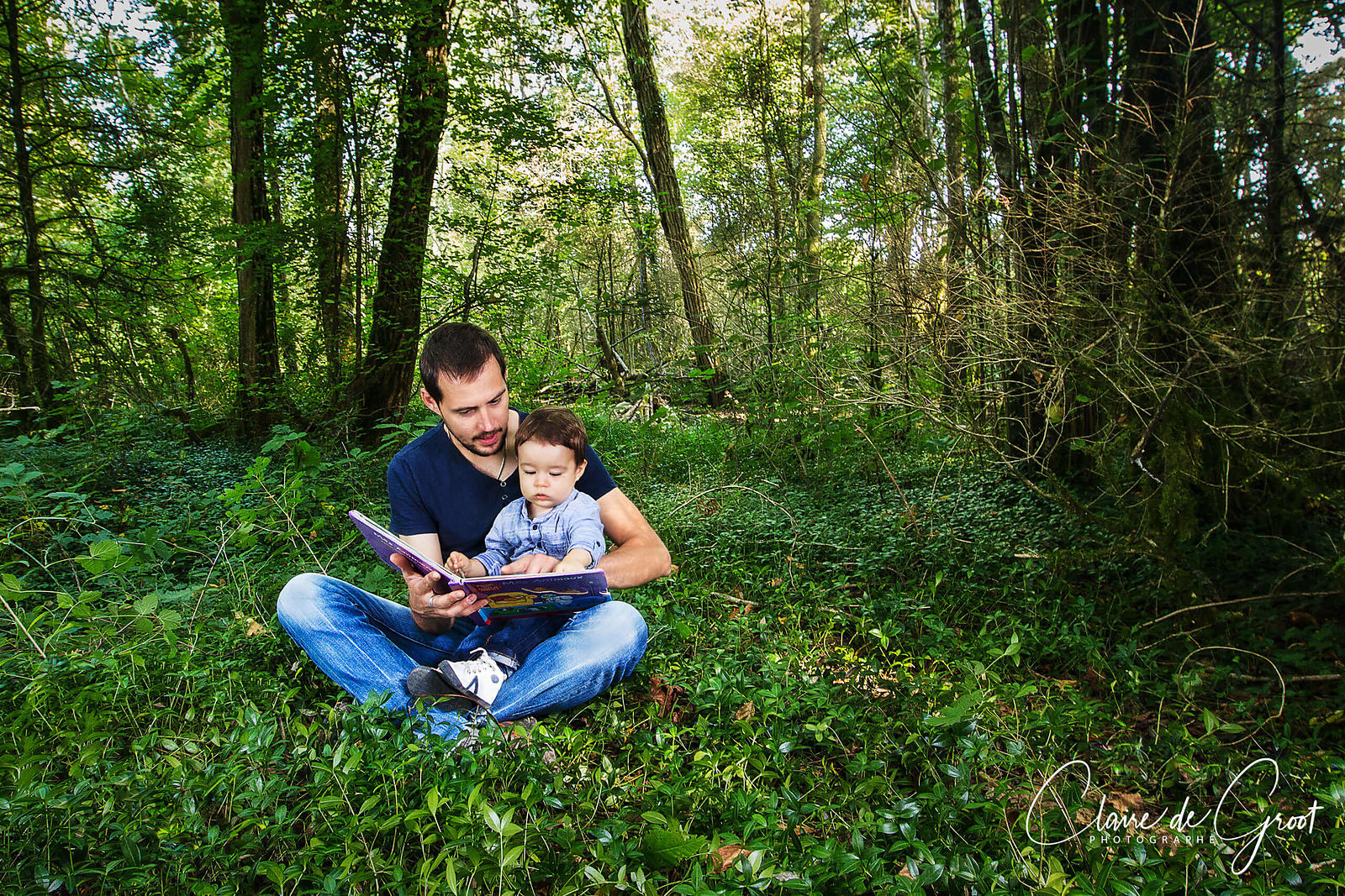 Portrait of a father and son in the forest