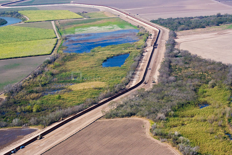 Aerial view of the US / Mexico border wall in Hidalgo County showing how wildlife corridors are severed, reduced, or eliminat...