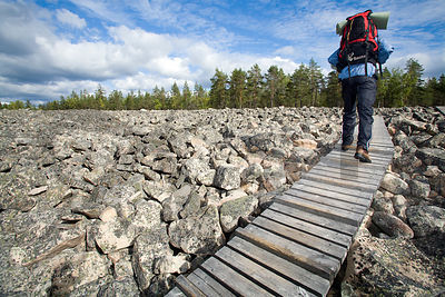 Hiker crossing Kivijata Stone Field