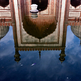 The Jama Masjid reflected in a pool for ritual ablutions, Old Delhi, India