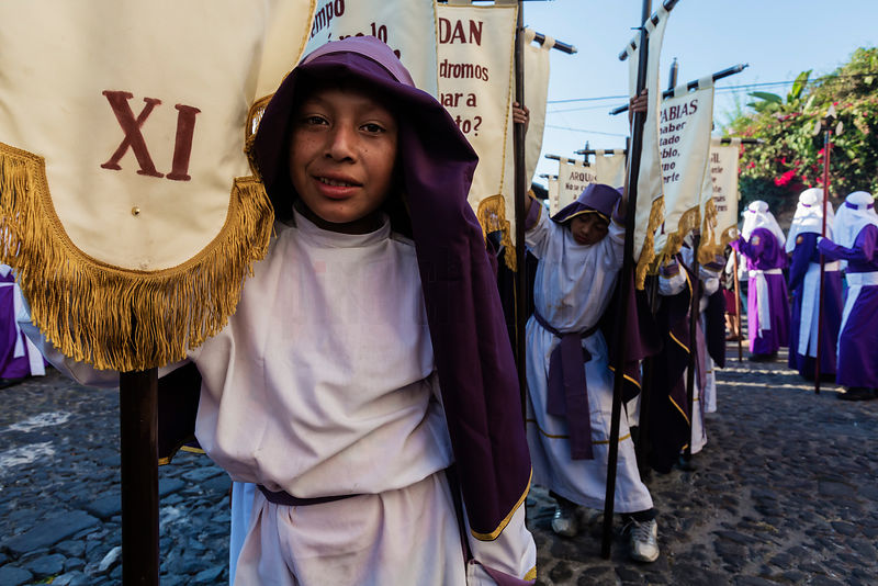 Portrait of Kids Carrying Banners During Semana Santa Good Friday Parade