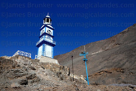 Old clock tower on hillside above Pisagua , Region I , Chile