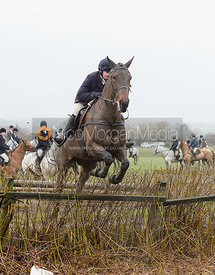 Charlotte Wright jumping a hedge near Pasture Lane