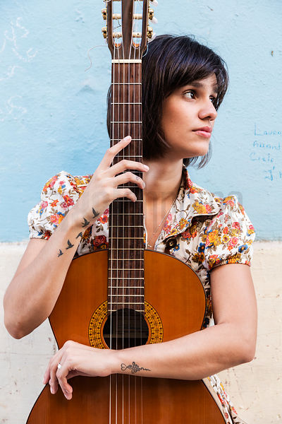 Portrait of a Musician with her Guitar
