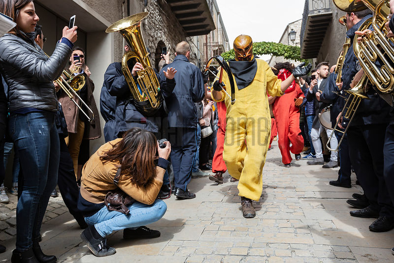 Death, masked and dressed in yellow robes, with a crossbow in his hand, walks through the city searching for souls to take to...