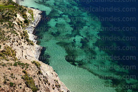 View of clear turquoise water and rocky shoreline, Sun Island, Lake Titicaca, Bolivia