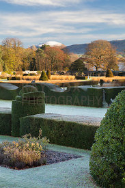 Clipped yew hedges, grasses; Loch Leven and Lomond Hills