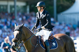 Harrie Smolders rides Don VHP Z at the longines Global Champions tour Grand Prix in Hamburg.