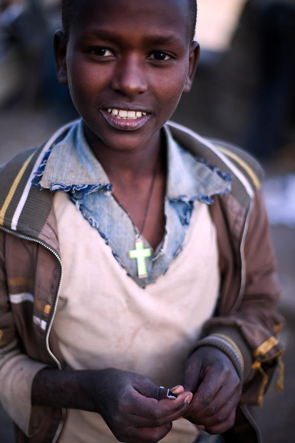 Ethiopia - Addis Ababa - A street boy with a crucifix