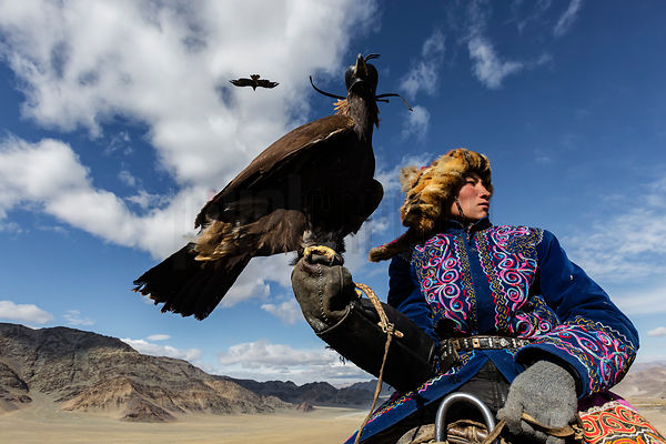 Young Golden Eagle Hunter Holding his Bird