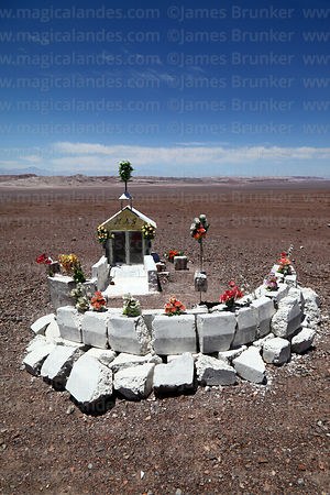 Roadside shrine (called animita de carretera in Chile) to traffic accident victim next to road between San Pedro de Atacama a...