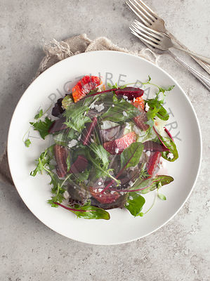 Blood Orange, Beetroot and Goat's Cheese Salad on Grey Background