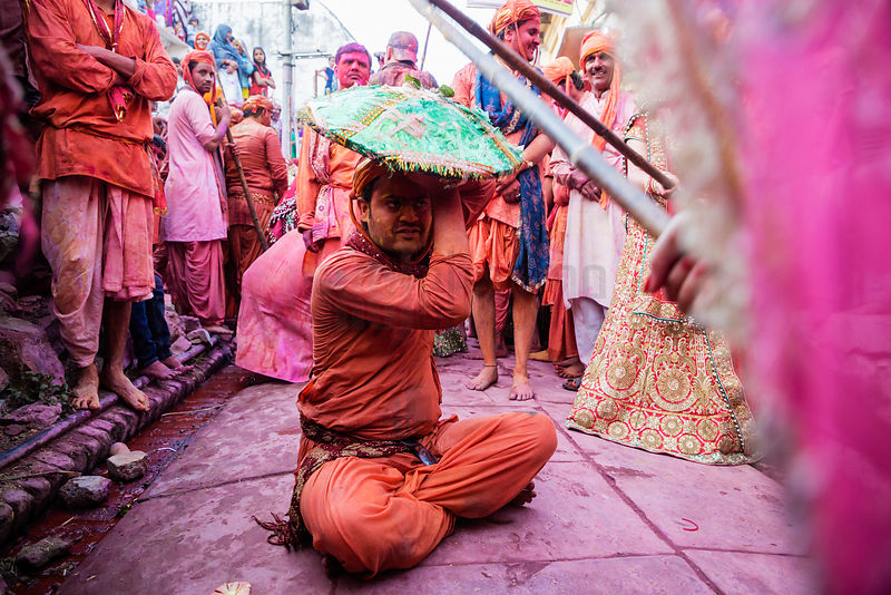 Gopis of Nandgaon Beat the Gops of Nandgaon with Long Sthicks (Laths) During Lathmar Holi Celebrations
