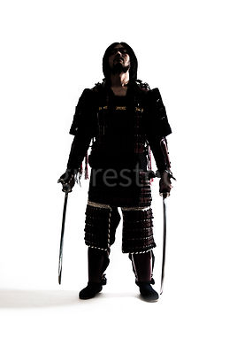 A semi-silhouette of a Samurai warrior - shot from mid-level.