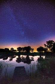 Milkyway over a pond at night
