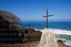 Rusted cross on headland above Bahia Camarones and Punta Camarones , Region XV, Chile