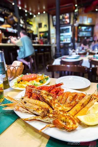 Mixed grilled seafood in a restaurant, Madrid, Spain