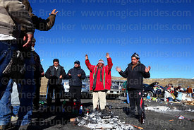 Aymara shaman or yatiri leading ritual while making offerings to Pachamama, La Cumbre, Cordillera Real, Bolivia