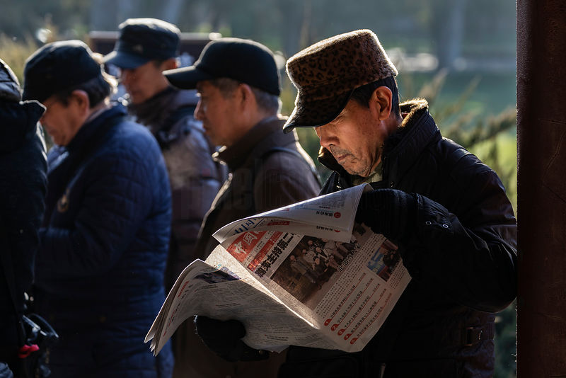 Man Reading a Newspaper at Tiantan Park