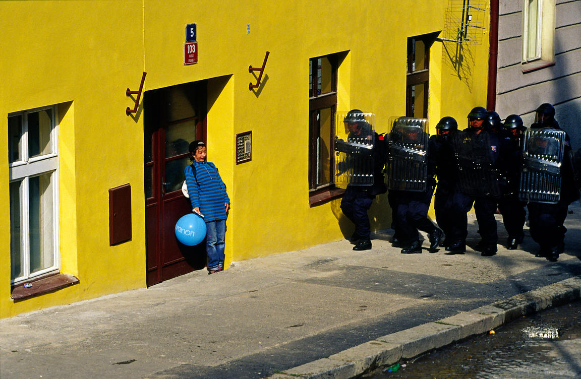 Czech Republic - Prague - A drunken protester attempts to hide in a doorway as riot police charge