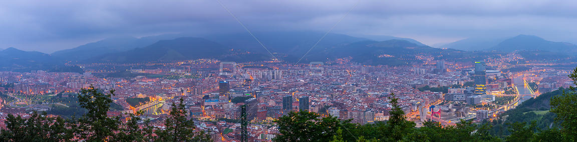 View over Bilbao at dusk, Bizkaia, Basque Country, Spain, July 2014.