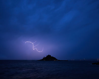 Intense night time storm with lightning, heavy rain and strong wind at St Michael's Mount in Marazion, Cornwall