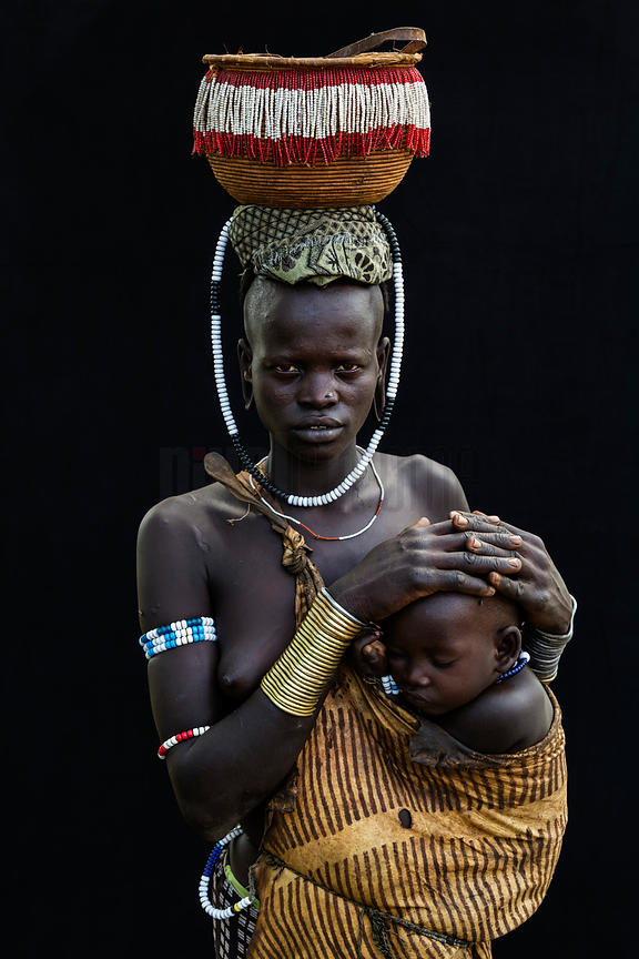 Portrait of a Mursi Woman with a Child